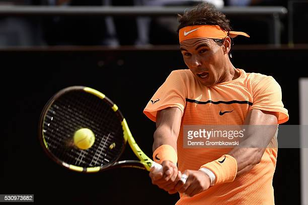 Rafael Nadal of Spain plays a backhand in his match against Nick Kyrgios of Australia on Day Five of The Internazionali BNL d'Italia on May 12 2016...