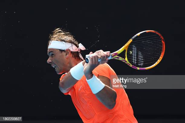 Rafael Nadal of Spain plays a backhand in his Men's Singles fourth round match against Fabio Fognini of Italy during day eight of the 2021 Australian...