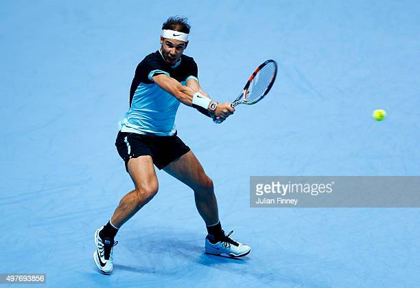 Rafael Nadal of Spain plays a backhand in his men's singles match against Andy Murray of Great Britain during day four of the Barclays ATP World Tour...