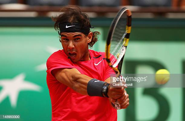 Rafael Nadal of Spain plays a backhand in his men's singles semi final match against David Ferrer of Spain during day 13 of the French Open at Roland...