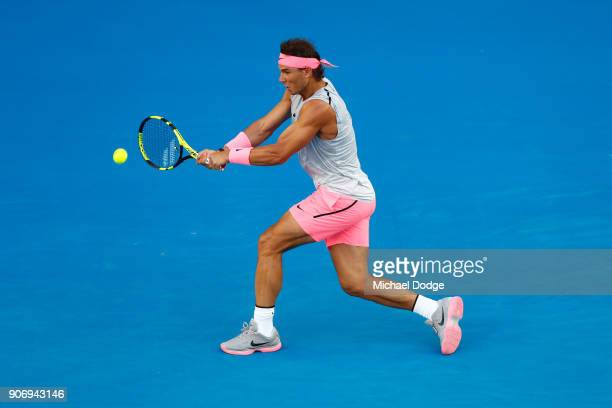 Rafael Nadal of Spain plays a backhand in his third round match against Damir Dzumhur of Bosnia and Herzogovina on day five of the 2018 Australian...