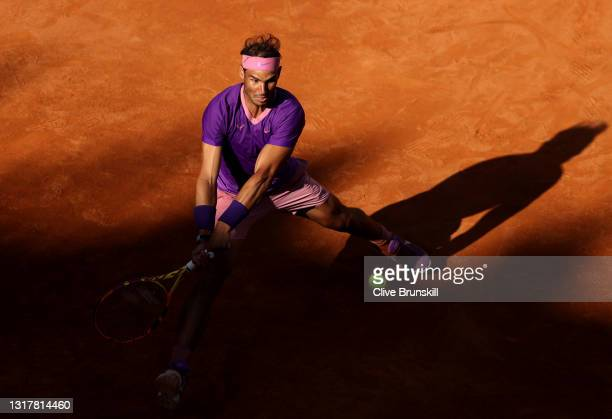 Rafael Nadal of Spain plays a backhand in their mens singles third round match against Denis Shapovalov of Canada during Day Six of the...