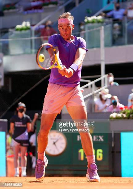 Rafael Nadal of Spain plays a backhand shot in his Quarterfinals match against Alexander Zverev of Germany on day nine of the Mutua Madrid Open...