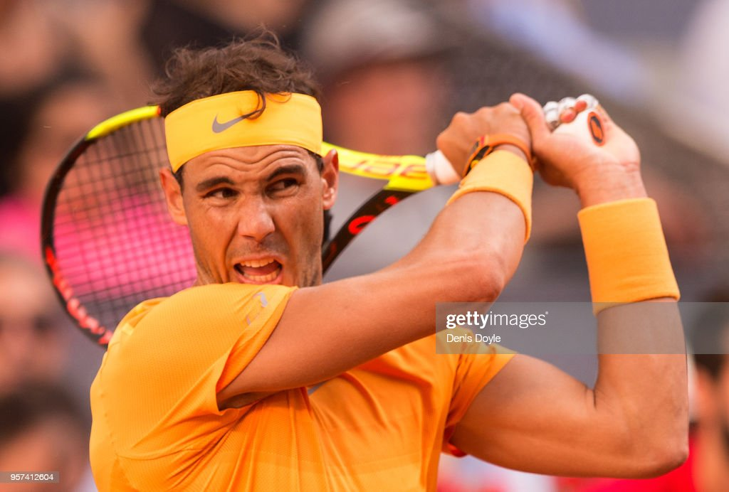 Rafael Nadal of Spain plays a backhand to Dominic Thiem of Austria during their quarterfinal match on day seven of Mutua Madrid Open at the Caja Magica on May 11, 2018 in Madrid, Spain.