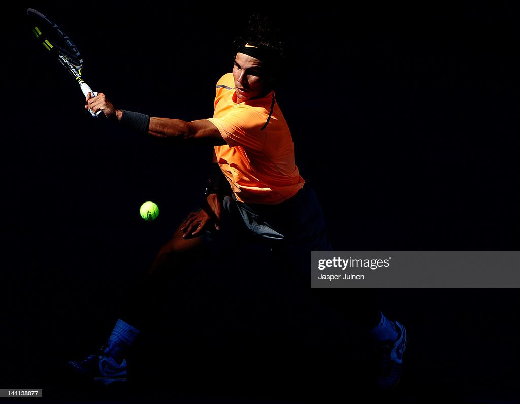 Rafael Nadal of Spain plays a backhand to his fellow countryman Fernando Verdasco during the Mutua Madrilena Madrid Open tennis tournament at the Caja Magica on May 10, 2012 in Madrid, Spain.