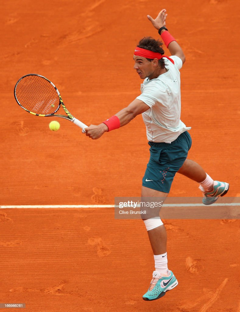 Rafael Nadal of Spain plays a backhand volley against Grigor Dimitrov of Bulgaria in their quarter final match during day six of the ATP Monte Carlo Masters, at Monte-Carlo Sporting Club on April 19, 2013 in Monte-Carlo, Monaco.