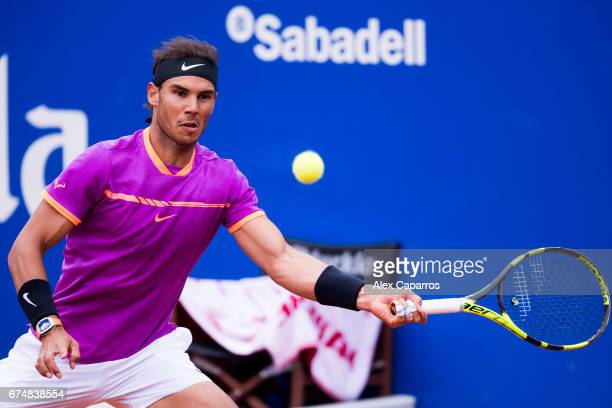 Rafael Nadal of Spain plays a forehand against Horacio Zeballos of Argentina in their semifinal match on day six of the Barcelona Open Banc Sabadell...