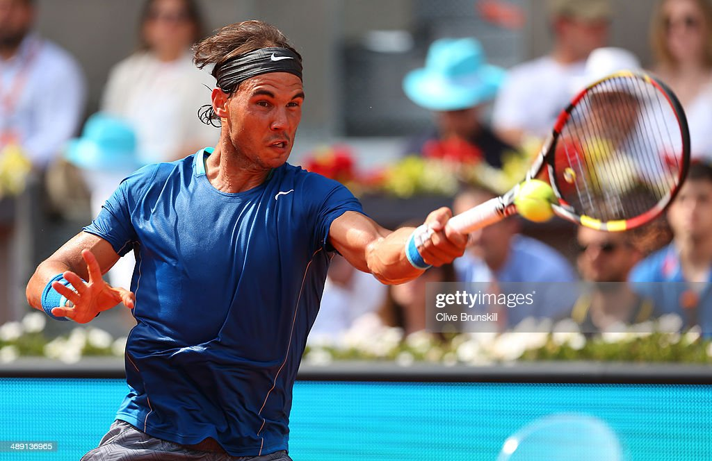Rafael Nadal of Spain plays a forehand against Roberto Bautista Agut of Spain in their semi final match during day eight of the Mutua Madrid Open tennis tournament at the Caja Magica on May 10, 2014 in Madrid, Spain.