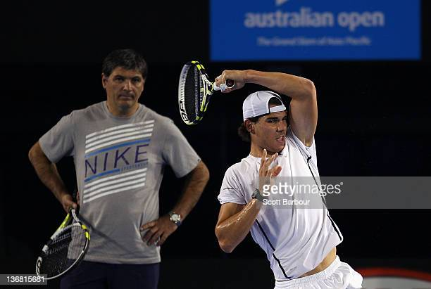 Rafael Nadal of Spain plays a forehand as he is watched by Toni Nadal his uncle and coach during practice ahead of the 2012 Australian Open at Rod...