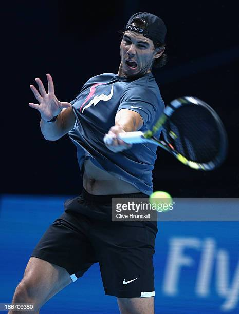 Rafael Nadal of Spain plays a forehand during a practice session prior to the start of ATP World Tour Finals Tennis at O2 Arena on November 3 2013 in...