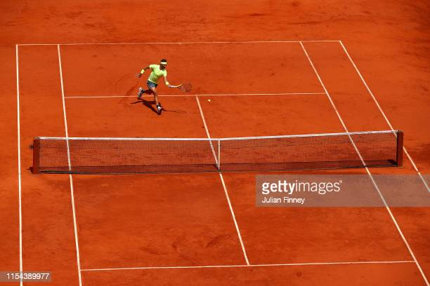 Rafael Nadal of Spain plays a forehand during his mens singles semi-final match against Roger Federer of Switzerland during Day thirteen of the 2019...