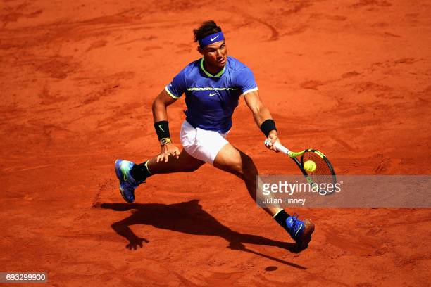 Rafael Nadal of Spain plays a forehand during mens singles quarter finals match against Pablo Carreno Busta of Spain on day eleven of the 2017 French...