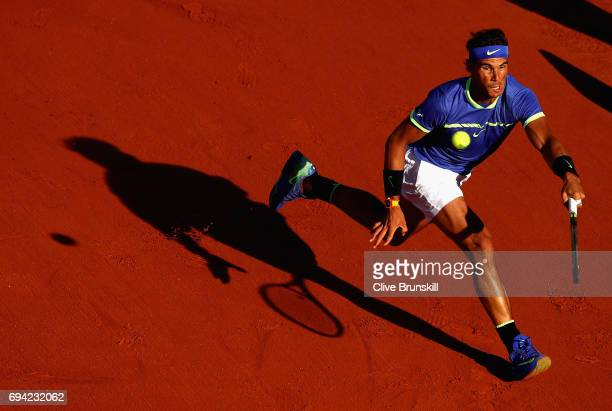 Rafael Nadal of Spain plays a forehand during mens singles semifinal match against Dominic Thiem of Austria on day thirteen of the 2017 French Open...