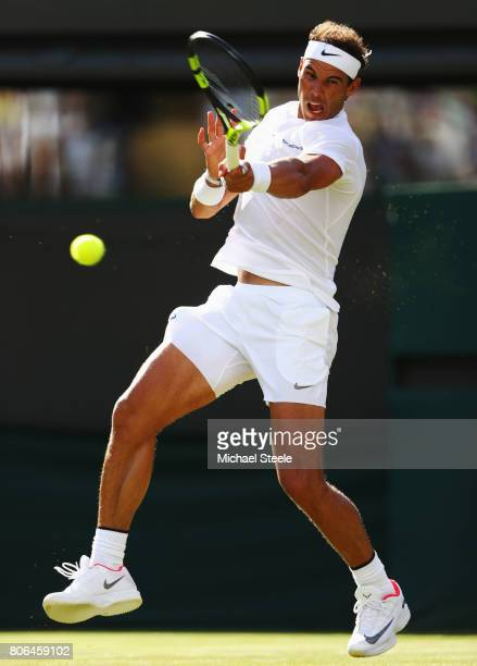 Rafael Nadal of Spain plays a forehand during the Gentlemen's Singles first round match against John Millman of Australia on day one of the Wimbledon...