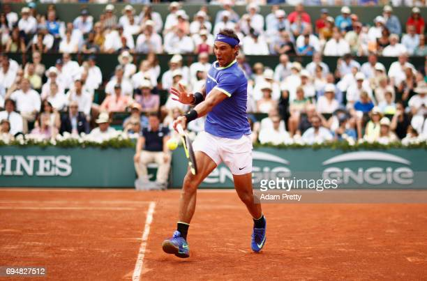 Rafael Nadal of Spain plays a forehand during the men's singles final against Stan Wawrinka of Switzerland on day fifteen of the French Open at...