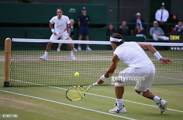 Rafael Nadal of Spain plays a forehand during the men's singles Final match against Roger Federer of Switzerland on day thirteen of the Wimbledon...