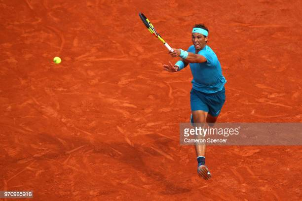 Rafael Nadal of Spain plays a forehand during the mens singles final against Dominic Thiem of Austria during day fifteen of the 2018 French Open at...