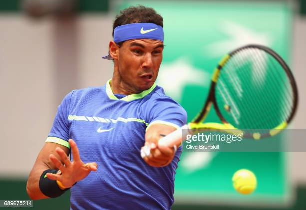 Rafael Nadal of Spain plays a forehand during the mens singles first round match against Benoit Paire of France on day two of the 2017 French Open at...