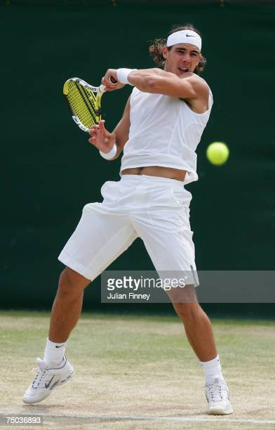 Rafael Nadal of Spain plays a forehand during the Men's Singles fourth round match against Mikhail Youzhny of Russia during day ten of the Wimbledon...