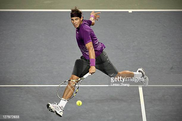Rafael Nadal of Spain plays a forehand in his first round match against Go Soeda of Japan during day two of the Rakuten Open at Ariake Colosseum on...
