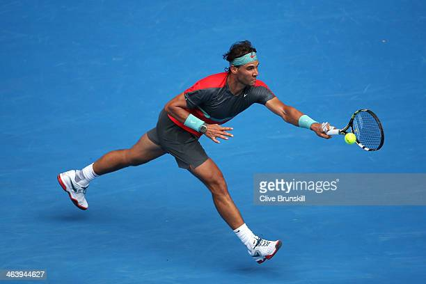 Rafael Nadal of Spain plays a forehand in his fourth round match against Kei Nishikori of Japan during day eight of the 2014 Australian Open at...