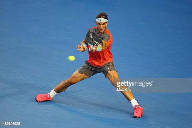 Rafael Nadal of Spain plays a forehand in his his men's final match against Stanislas Wawrinka of Switzerland during day 14 of the 2014 Australian...