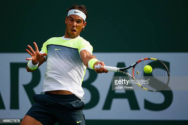 Rafael Nadal of Spain plays a forehand in his match against Donald Young of USA during day nine of the BNP Paribas Open tennis at the Indian Wells...