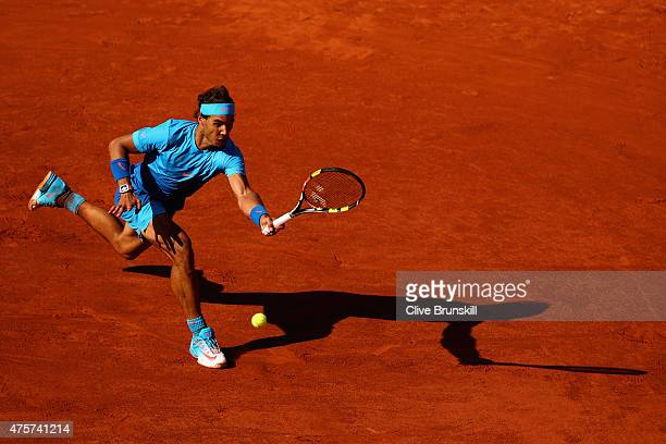 Rafael Nadal of Spain plays a forehand in his Men's quarter final match against Novak Djokovic of Serbia on day eleven of the 2015 French Open at...