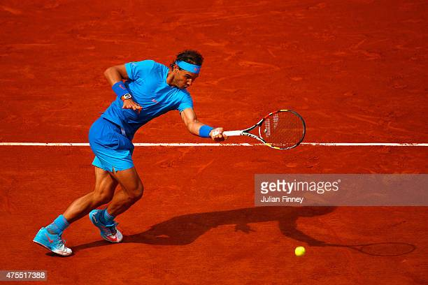 Rafael Nadal of Spain plays a forehand in his Men's Singles match against Jack Sock of the United States on day nine of the 2015 French Open at...
