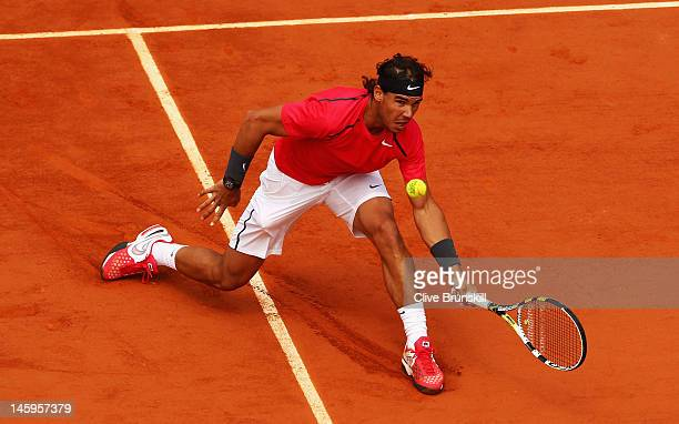 Rafael Nadal of Spain plays a forehand in his men's singles semi final match against David Ferrer of Spain during day 13 of the French Open at Roland...