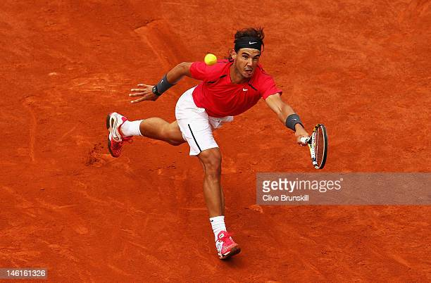 Rafael Nadal of Spain plays a forehand in the men's singles final against Novak Djokovic of Serbia during day 16 of the French Open at Roland Garros...