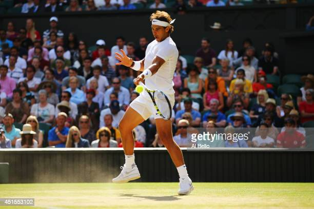 Rafael Nadal of Spain plays a forehand return during his Gentlemen's Singles fourth round match against Nick Kyrgios of Australia on day eight of the...