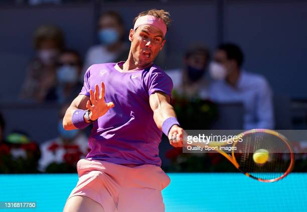 Rafael Nadal of Spain plays a forehand shot in his Quarterfinals match against Alexander Zverev of Germany on day nine of the Mutua Madrid Open...