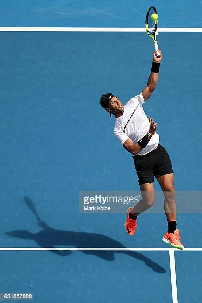 Rafael Nadal of Spain plays a forehand smash in his first round match against Florian Mayer of Germany on day two of the 2017 Australian Open at...