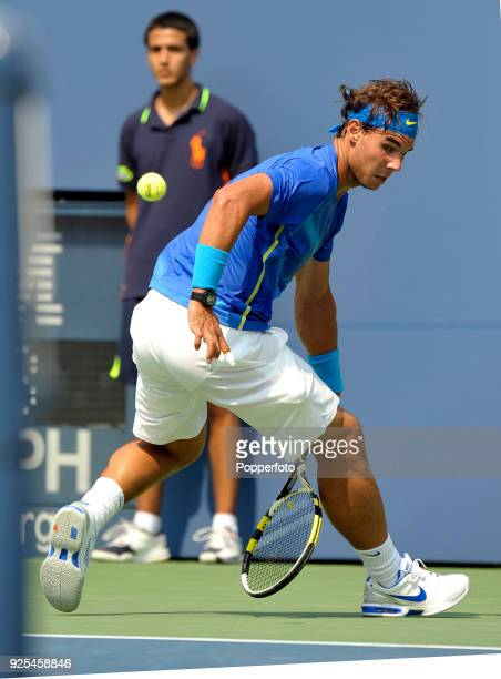 Rafael Nadal of Spain plays a 'hot dog' shot against David Nalbandian of Argentina during Day Seven of the 2011 US Open at the USTA Billie Jean King...