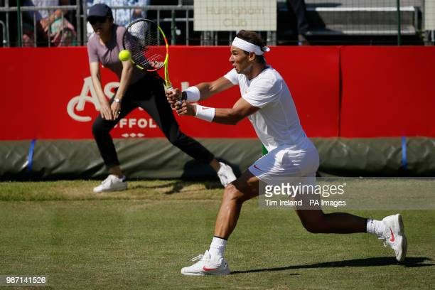 Rafael Nadal of Spain plays a return to Lucas Pouille of France during day four of the Aspall Classic at the Hurlingham Club London