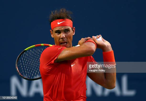 Rafael Nadal of Spain plays a shot against Benoit Paire of France during a 2nd round match on Day 3 of the Rogers Cup at Aviva Centre on August 8...