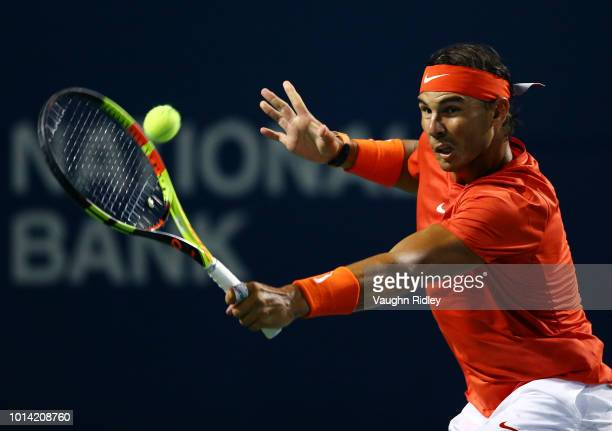 Rafael Nadal of Spain plays a shot against Stan Wawrinka of Switzerland during a 3rd round match on Day 4 of the Rogers Cup at Aviva Centre on August...