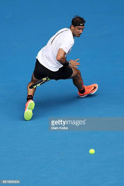 Rafael Nadal of Spain plays a shot through his legs in his first round match against Florian Mayer of Germany on day two of the 2017 Australian Open...