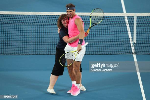Rafael Nadal of Spain plays tennis with Deb from the CFA during the Rally for Relief Bushfire Appeal event at Rod Laver Arena on January 15 2020 in...