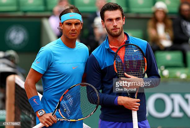 Rafael Nadal of Spain poses at the net with Quentin Halys of France before their men's singles match on day three of the 2015 French Open at Roland...