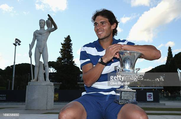 Rafael Nadal of Spain poses for a photo in front of the statues of Pietrangeli court after his straight sets victory against Roger Federer of...