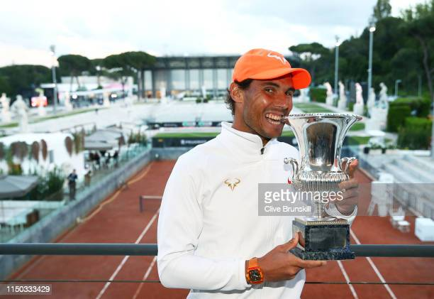Rafael Nadal of Spain poses for a photograph with his winners trophy after his three set victory against Novak Djokovic of Serbia in the men's final...