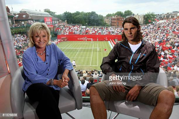 Rafael Nadal of Spain poses for a picture next to BBC presenter Sue Barker after an interview on Day 3 of the Artois Championships at Queen's Club on...