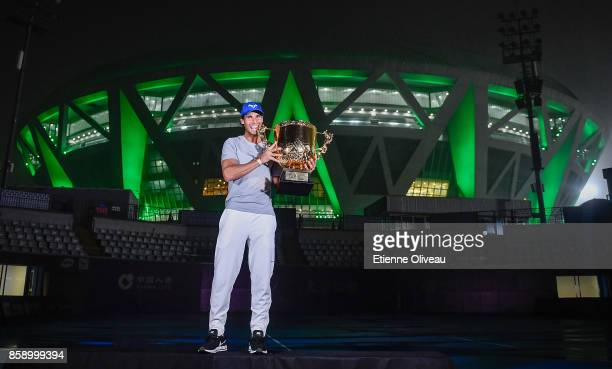 Rafael Nadal of Spain poses for a picture with the winner's trophy after winning the Men's Singles final against Nick Kyrgios of Australia on day...