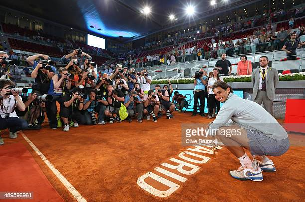 Rafael Nadal of Spain poses for photographers with his winners trophy after victory over Kei Nishikori of Japan in their final match during day nine...