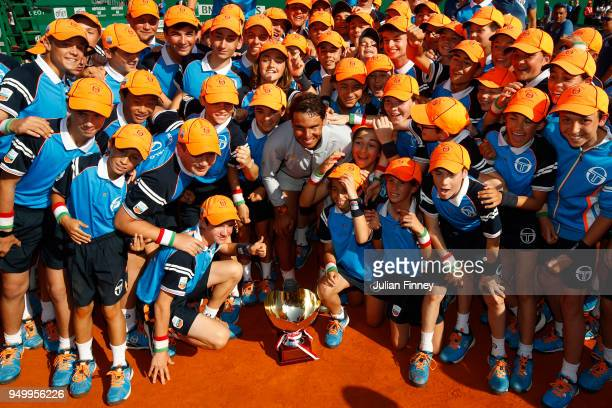 Rafael Nadal of Spain poses his winners trophy and the ball kids after winning the Monte Carlo Rolex Masters against Kei Nishikori of Japan during...
