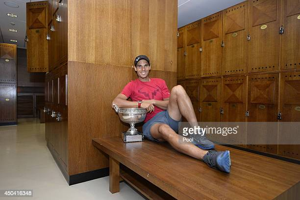 Rafael Nadal of Spain poses in the locker room with the Coupe des Mousquetaires trophy after the men's singles final against Novak Djokovic of Serbia...