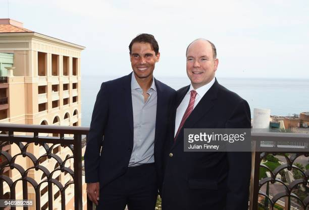 Rafael Nadal of Spain poses on his balcony with Albert II Prince of Monaco during Day Two of the ATP Masters Series Monte Carlo Rolex Masters at...