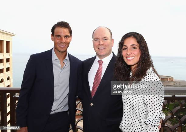 Rafael Nadal of Spain poses on his balcony with his girlfriend Maria Francisca Perello and Albert II, Prince of Monaco during Day Two of the ATP...